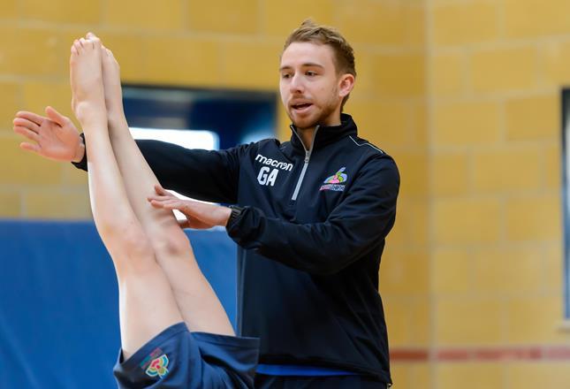 Gymnastics coach ()